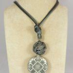 Ciondolo con elemento argento antico
